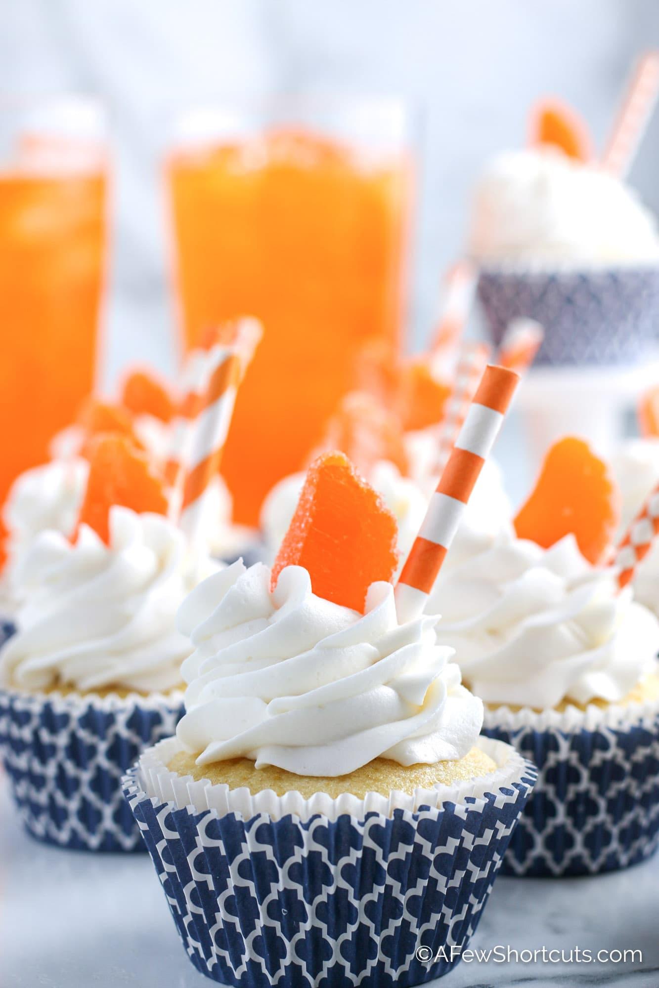 Orange Creamsicle Cupcakes with orange candy and orange straw