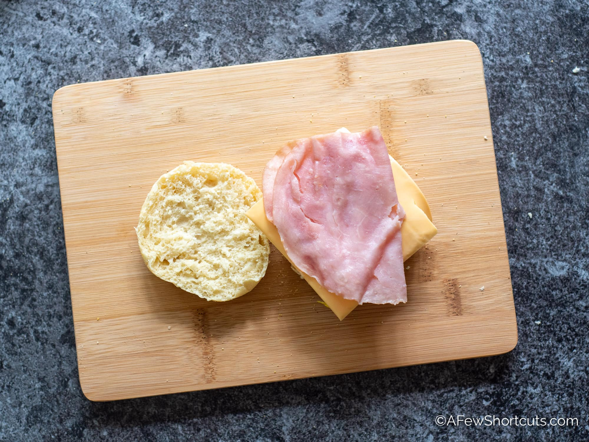 Cheese and ham on egg and English muffin