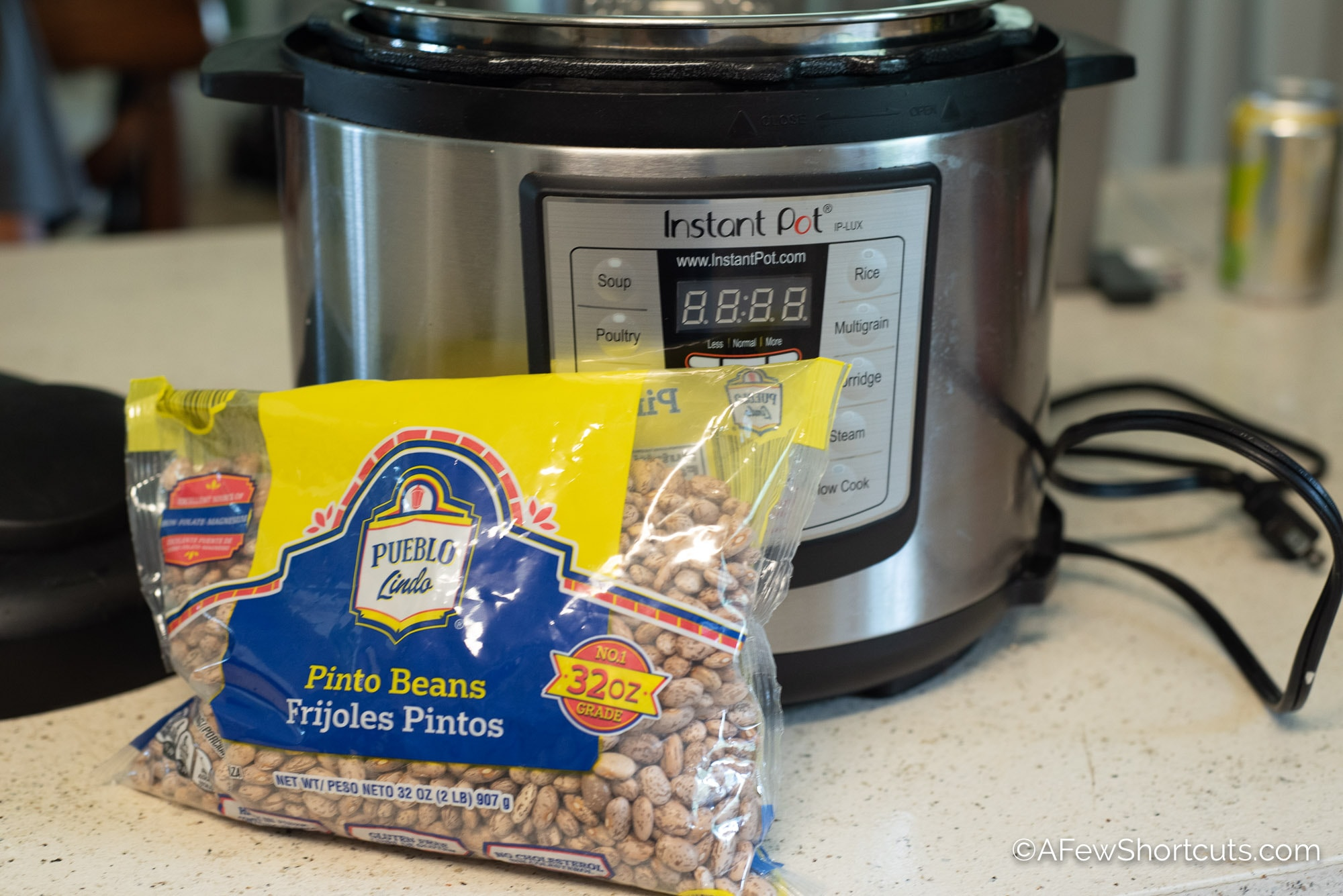 Instant pot and dried pinto beans in bag