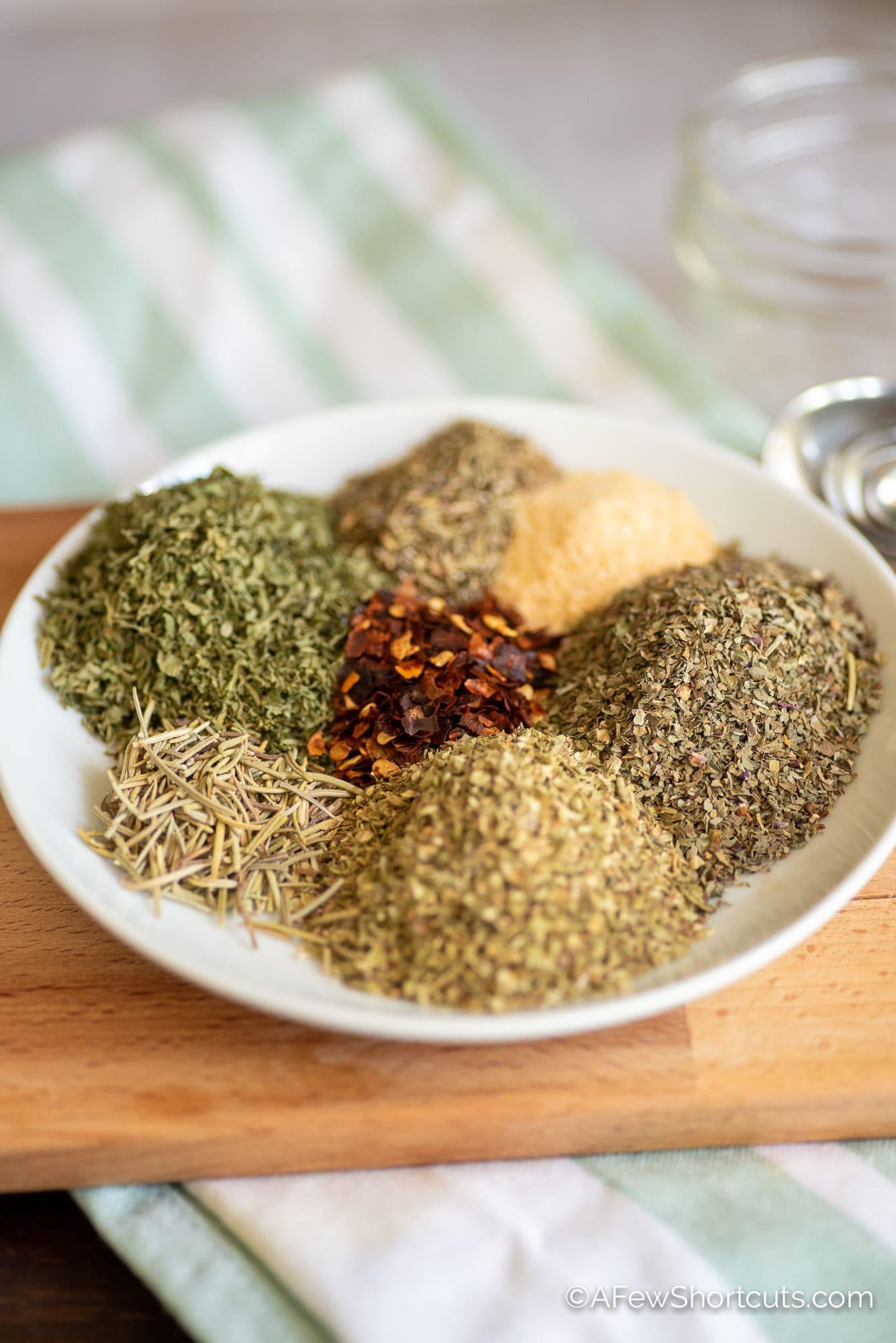 parsley, rosemary, oregano, red pepper, thyme, garlic, basil, on plate