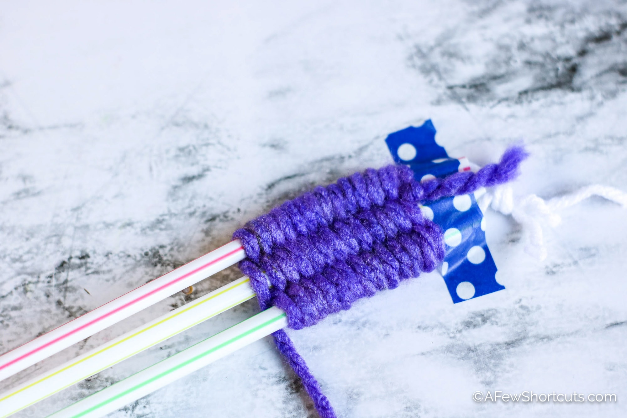Straw weaving with purple yarn