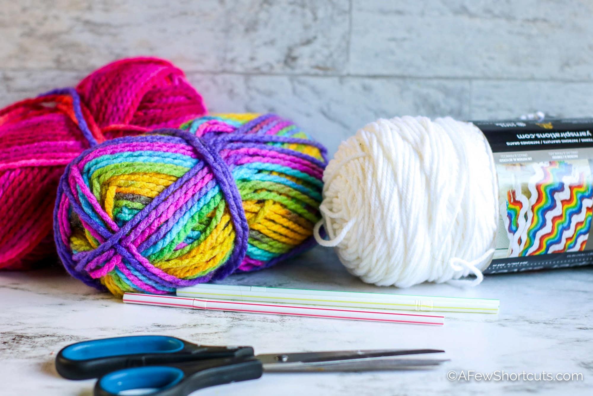 Yarn, straws, and scissors.